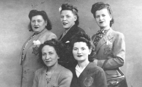 Jewish women wearing the required yellow badges. Paris, France, June 8, 1942 - US Holocaust Memorial Museum